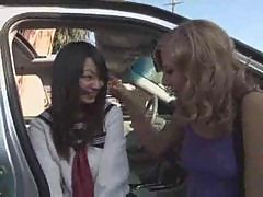 Cute Asian schoolgirl has interracial threesome outdoors