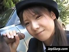Sexy Japanese Woman In Uniform Gives A Stud A Blowjob Outdoors