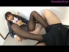 Schoolgirl In Pantyhose Giving Footjob For Guy..