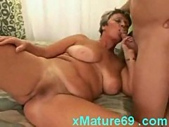Shorthaired housewife sucking cock