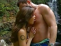 Tattooed Asian Charmane Star sucks and fucks cock by a water...